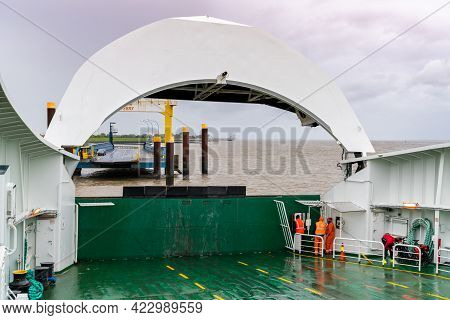 Brunsbuettel, Germany - 25 May, 2021: Ferry Crew Prepares To Dock At Harbor And Open Front End Of Fe