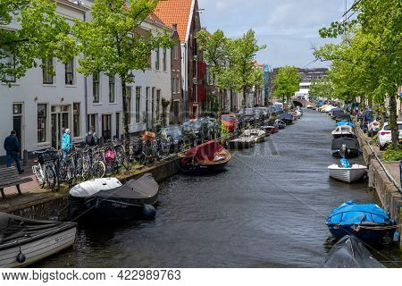 Colorful Houses And Small Boats On The Canals Of Haarlem