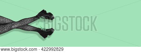 New Gray Female Boots On Long Slender Woman Legs In Gray Tights Isolated On Mint Background. Pop Art