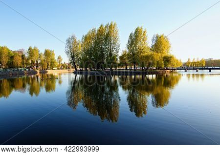Beautiful Landscape Photo Of Embankment In The Taras Shevchenko Park In Ternopil. Trees Reflected In