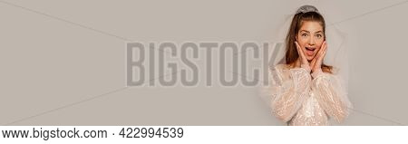 Astonished Woman In Wedding Dress Touching Face Isolated On Grey, Banner