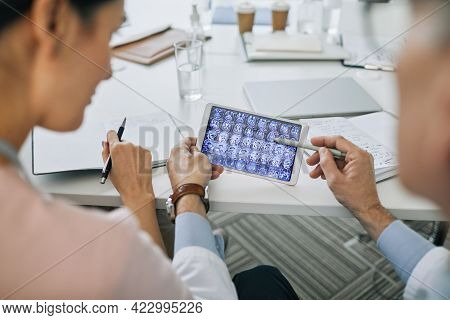 Close Up Of Two Doctors Looking At X-ray Images During Medical Council In Conference Room, Copy Spac