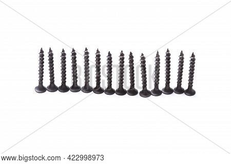 Self-tapping Screws Lined Up On Hats Isolated On White Background