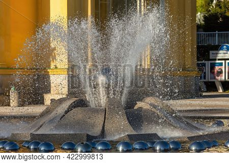 Marianske Lazne, Czech Republic - May 30 2021: Close View Of The Spurting Water Fountain. Yellow Col