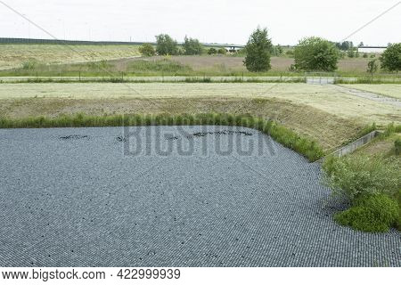Black Balls To Protect Reservoirs From The Sun. Shade Balls, Small Plastic Balls In The Pond To Keep