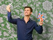 Man holding flag and miniature of airplane, wallpaper poster