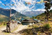 Prayer wall, prayer flags and village in Nepal poster