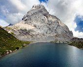 view of Wolayer See lago or Lago Volaya and Hohe Warte or Mount Coglians - Alpi Carniche or Karnische Alpen - Austria Itali border poster