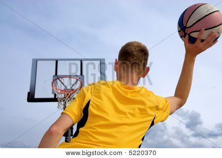 Teen Plays Basketball