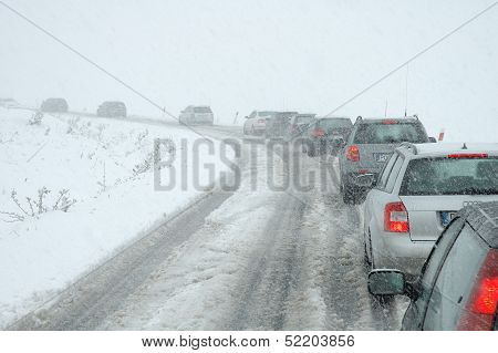 Traffic Jam In Heavy Snowfall On Mountain Road