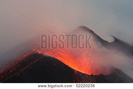 Volcano crater erupting