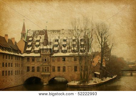 Hospice of the Holy Spirit (Heilig Geist Spital) in Nuremberg, Germany.  added  paper texture .  View from the Bridge on the River Pegnitz Museum and Heilig Geist Spital.