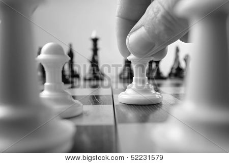 Person Making A Chess Move