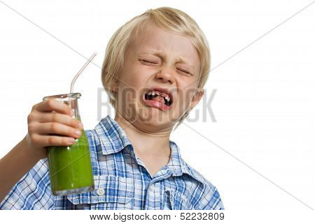 Boy Pulling Funny Face Holding Green Smoothie