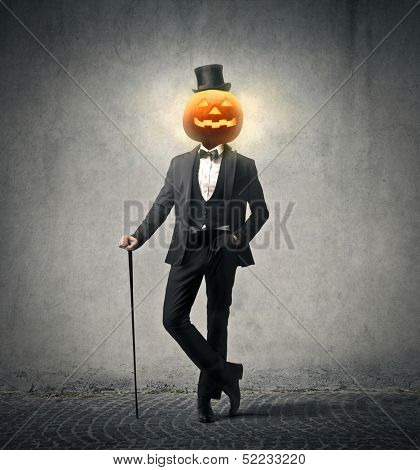 elegant man wearing suit and cylinder for the Halloween party