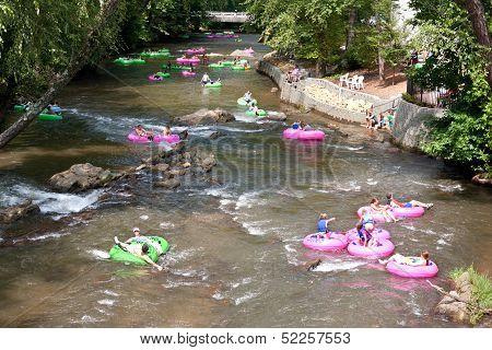 People Enjoy Tubing Down North Georgia River