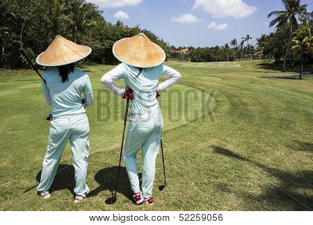 Two Caddies On Bali Golf Course