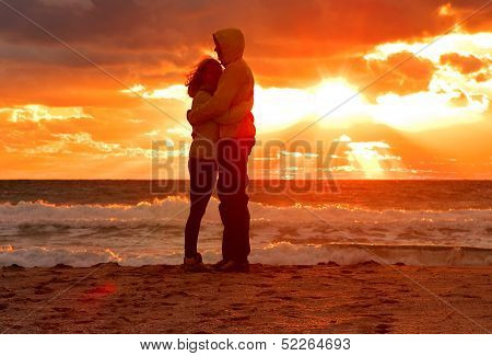 Man And Woman Hugging In Love with Sunset Scenery