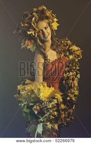 young woman with yellow and red leaves