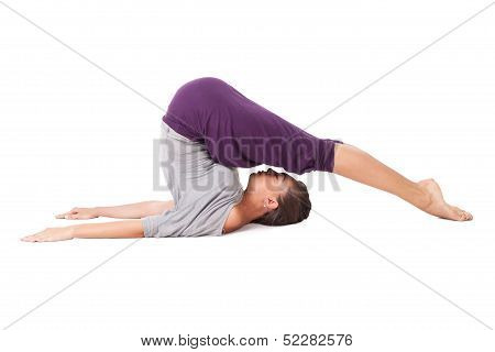 Young Woman Doing Yoga Exercise Halasana (plow Pose). Isolated On White