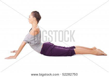 Young Woman Doing Yoga Exercise Bhujangasana (cobra Pose)