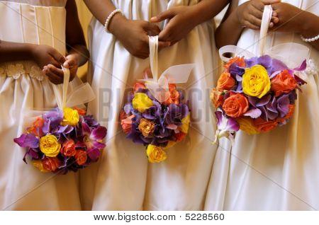 Three Flower Girls Holding Ball Bouquets