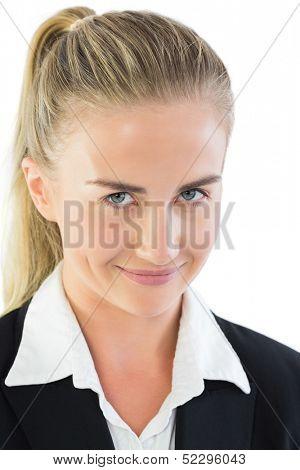 Portrait of impish pony tailed businesswoman on white background
