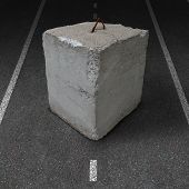 Roadblock obstacle and barrier business concept with a huge cement or concrete cube barricade blocking a road or highway as a symbol of restricted opportunity or political gridlock resulting in government or financial system shutdown. poster