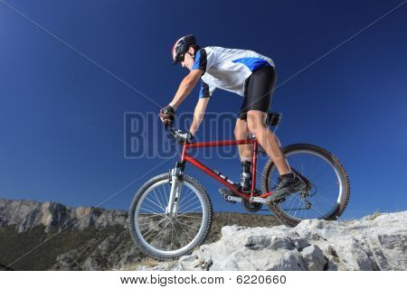Young Biker Riding A Mountain Bike