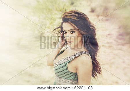 Beautiful young woman outdoors in nature with beautiful long hair