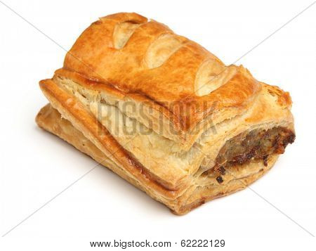 Homemade sausage roll on white background