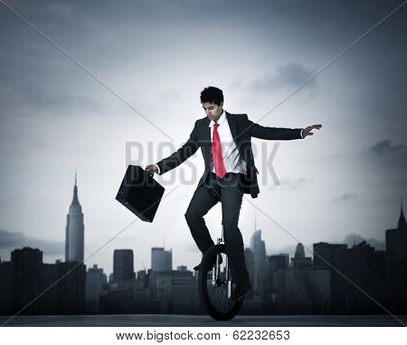 Businessman Taking a Risk on Unicycle in New York City