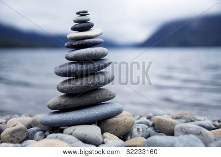 Zen Balancing Rocks Next to a Misty Lake, New Zealand