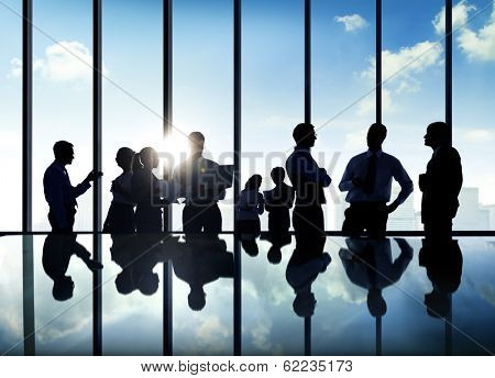 Silhouette of Business Discussion With Reflection