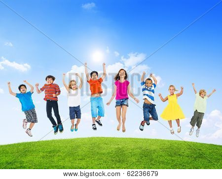 Group of Diverse Multi-Ethinc Children Jumping Outdoors