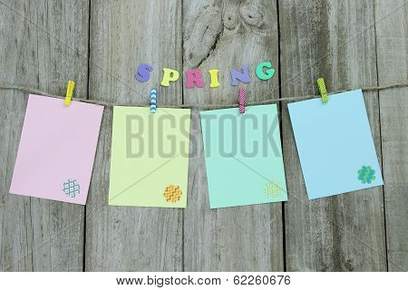 Blank pastel note cards hanging on clothesline