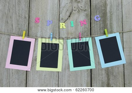 Pastel picture frames hanging on clothesline