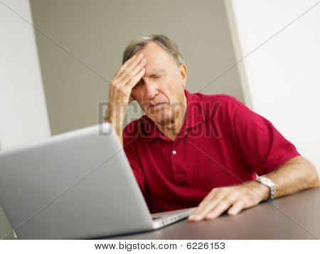 Senior Using Laptop Computer