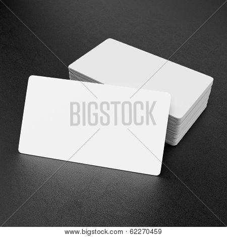 Business cards on black leather background