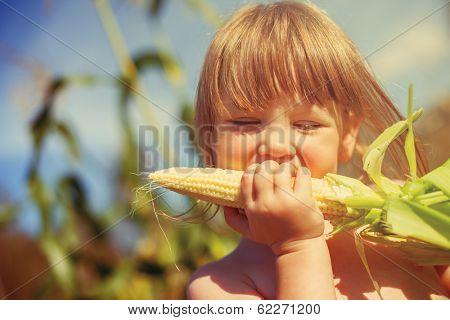 Little girl eating corn on the cob