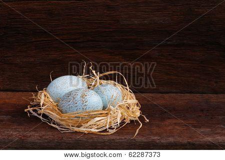 Easter Raffia Nest Duck Eggs On Rough Background