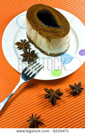 Tasty And Colorful Brown Coffee Cake With White Cream Layer.