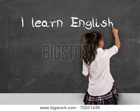 Schoolgirl Writing I Learn English With Chalk On Blackboard School Classroom