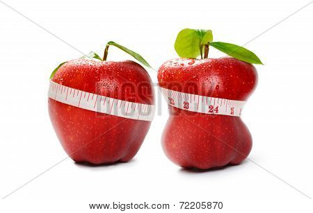 Closeup red apple with tapeline isolated over white Diet or weight loss concept
