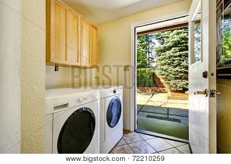 Laundry Room With Exit To Backyard Area