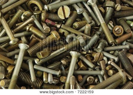 Old bolts screws nuts and pucks as background poster