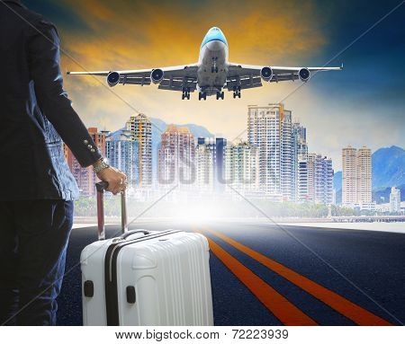 business man and luggage standing on airport runways with passenger jet plane flying above airport runway use for aircraft transport traveling journey trip with airline poster