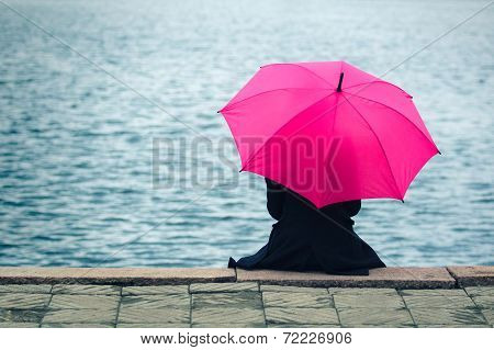 Woman with pink umbrella