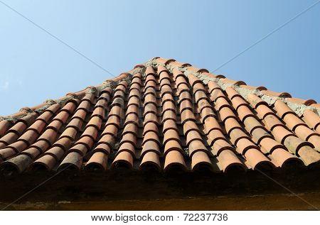Old Tile Roof On Blue Sky