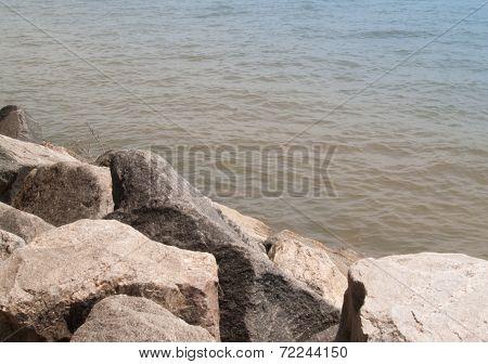 Boulders at edge of water